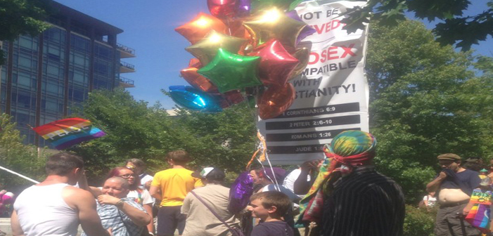 PIC: A Boy And His Balloons Stop Homophobic Protestors In Wisconsin