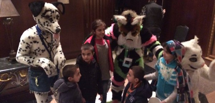 AWWWW! Furry Conference-Goers Comfort Syrian Child Refugees