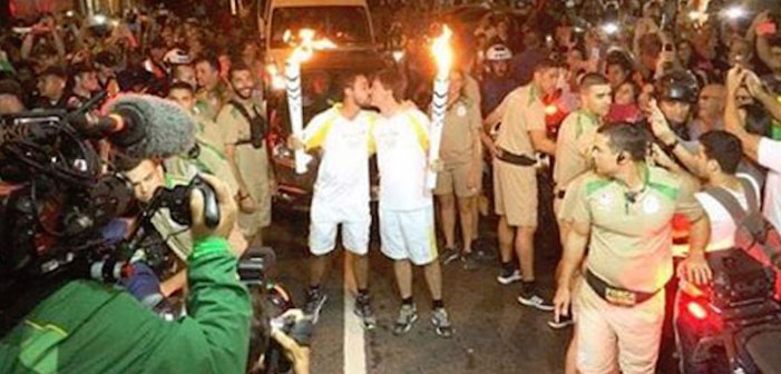 Flame On! Male Olympic Torchbearers Make Historic Kiss