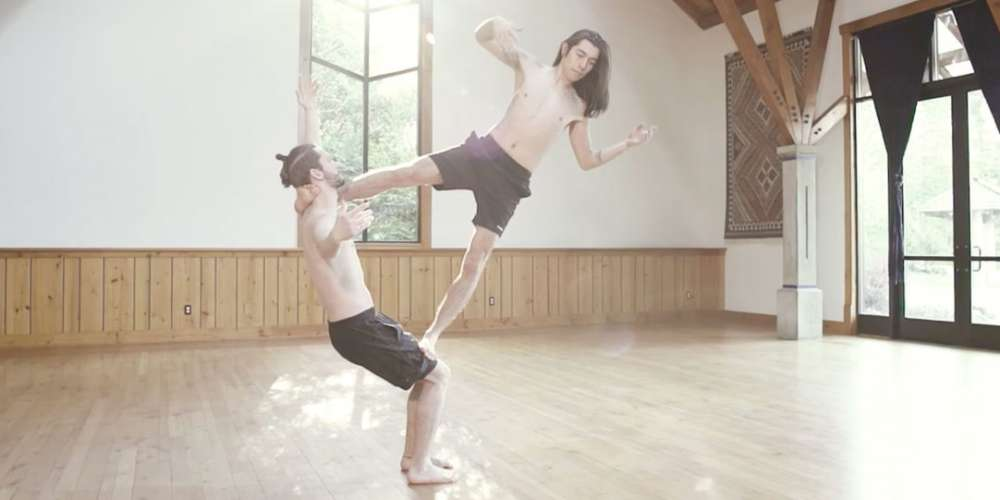 This Gay Couple's Shirtless Acrobatic Yoga is a Sexy Metaphor for Love … or Something (Video)