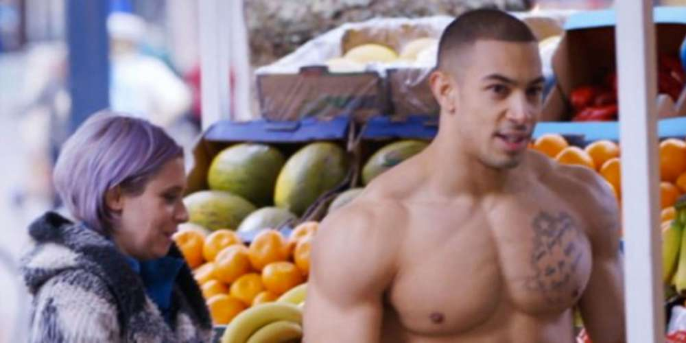 This Urban Camouflage Artist Helped a Nearly Nude Bodybuilder Blend into a Vegetable Stand