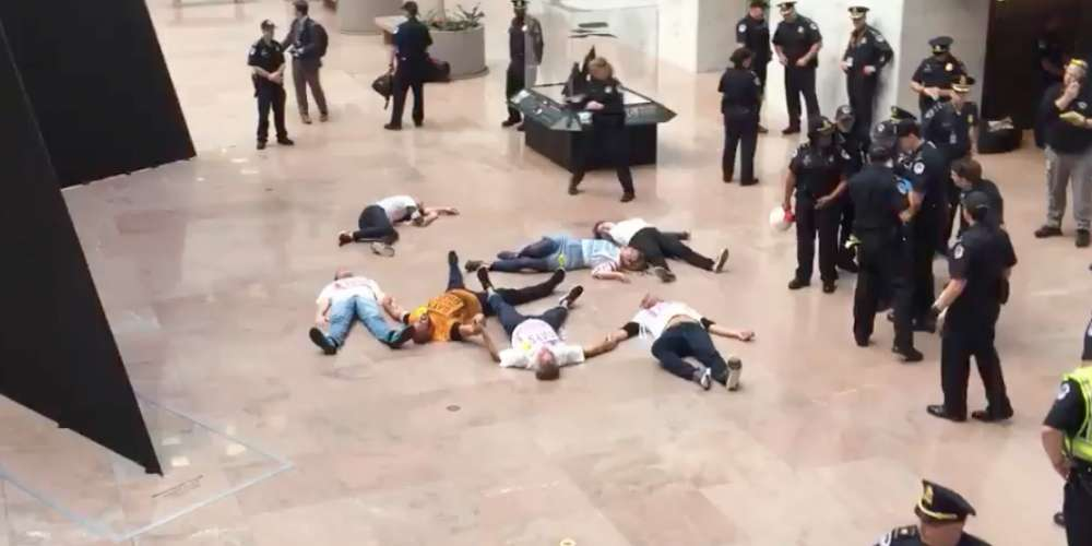 'Gays Against Guns' Hold Disruptive 'Die In' at Senate House Before Being Detained by Police