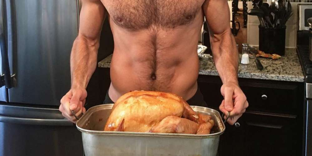 Celebrate Thanksgiving With Our Favorite Scruffy, Shirtless Hunk Holding a Turkey