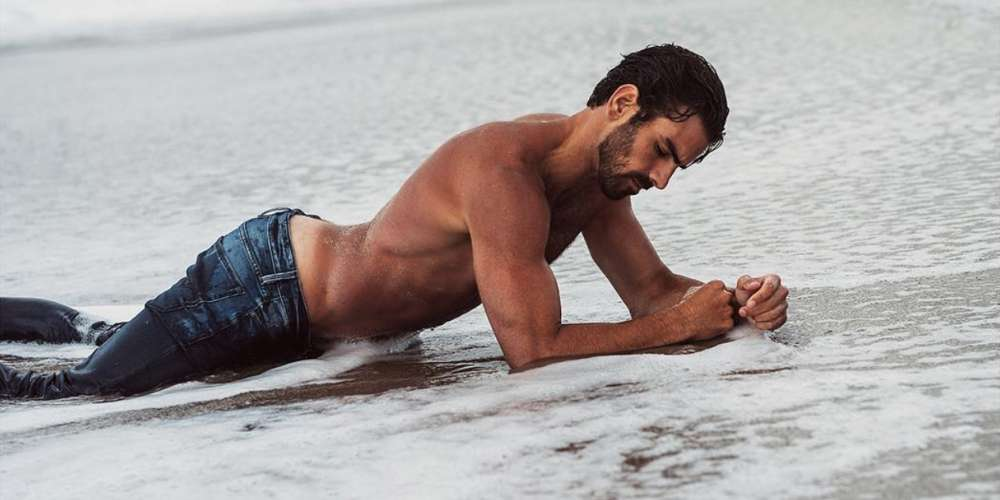 Nyle DiMarco Gets Completely Naked for 'Into the Wild' Mountaintop Pic