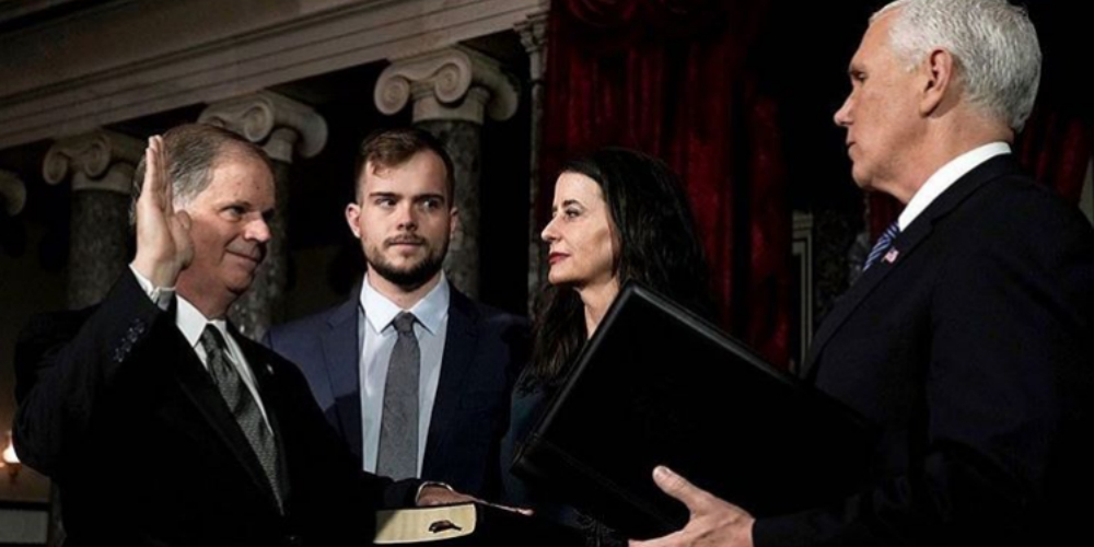 Doug Jones' Gay Son Gave Mike Pence Some Major Side-Eye at Today's Swearing In