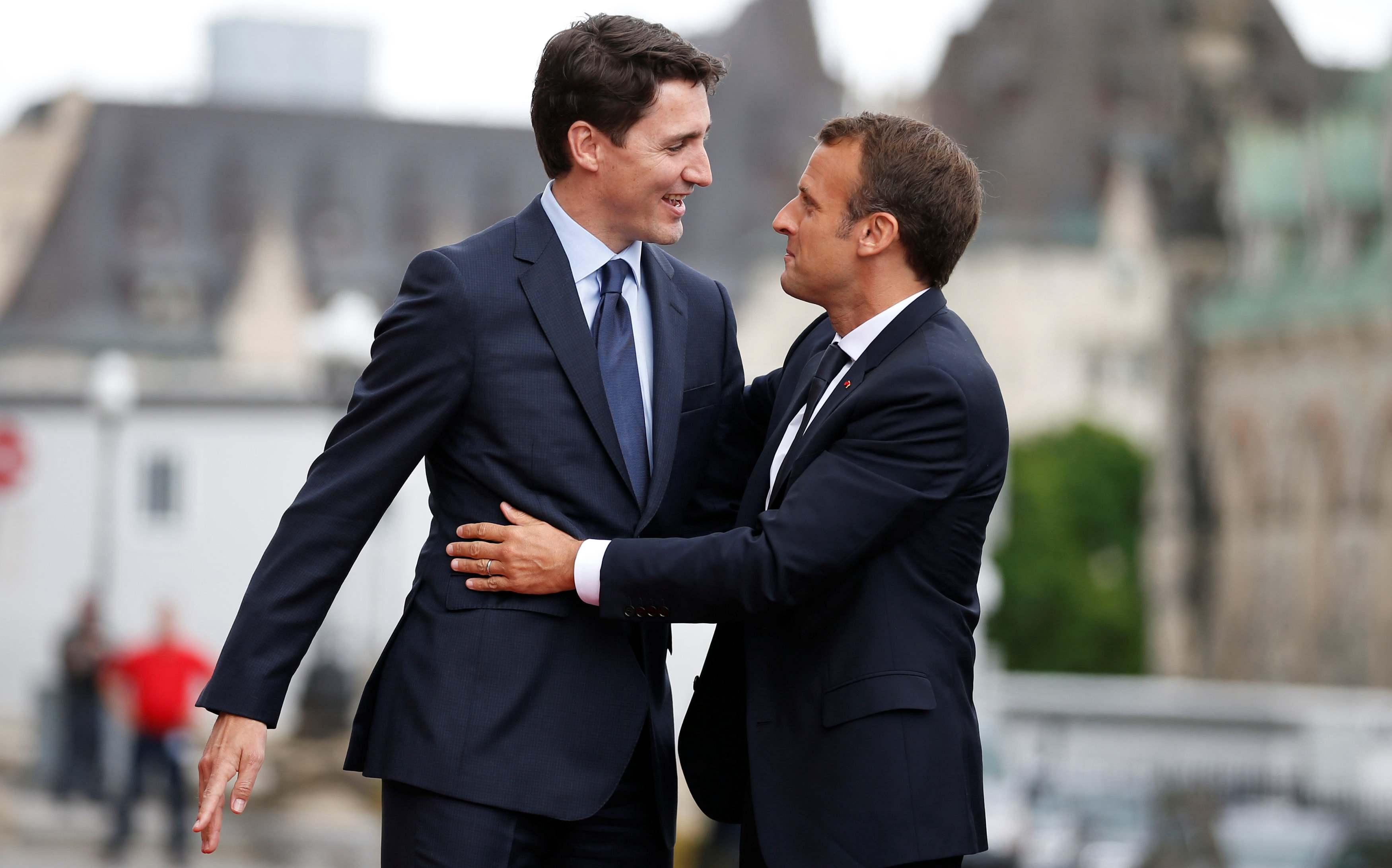 Macron shirtless