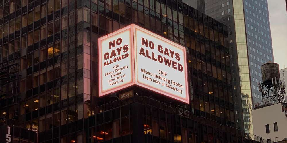 'No Gays Allowed' Billboard in Times Square Calls Out an Insidious Hate Group You've Never Heard Of
